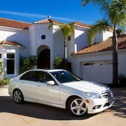 kereta mewah dan rumah