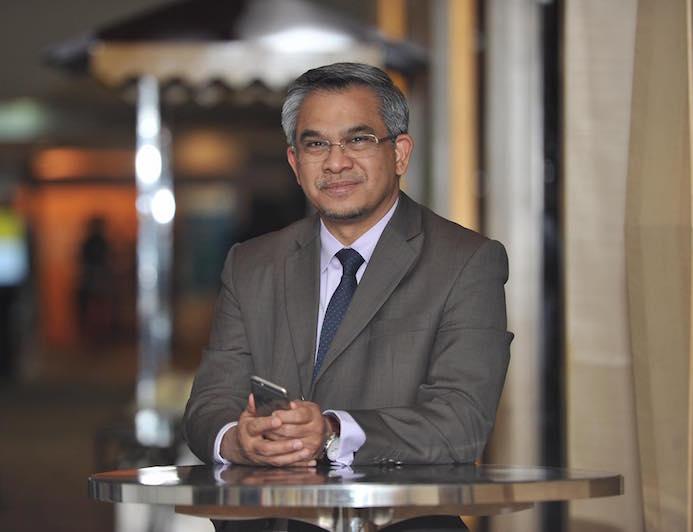 Datuk Dr Mohd Daud Bakar penasihat panel syariah public gold